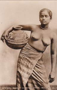 RP: Topless young native girl; Ceylon, 00-10s: Rodiya woman carrying water