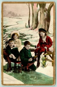 Winter Sports~Boy Helps Girl With Ice Skates~Kids Down at Creek~Sled Chair~1910