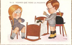 Boy and girl playing doctors Nice Spanish postcard 1930s