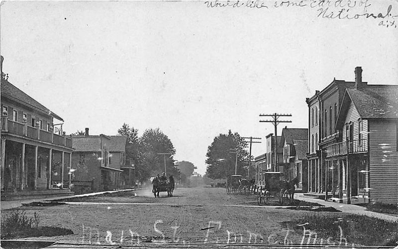 Emmet MI Dirt Main Street Store Fronts Horse & Wagons in 1907 RPPC Postcard
