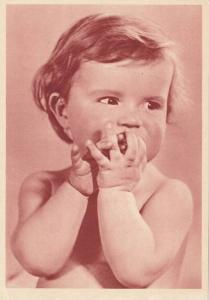 Portrait of toddler holding hands up to mouth, 10-20s