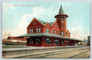 Oskaloosa Iowa~Iowa Central Station~Railroad Depot~Adv Billboards~RR Cars~c1910
