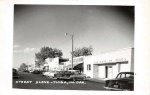 LPS59 Tioga North Dakota Town Street Store Front View Postcard RPPC