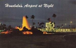 HONOLULU, Hawaii, 1940-60s; Honolulu's Airport at Night, Fountain resembling ...