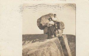 RP: BARABOO , Wis. , 1911 ; Men sitting on rock