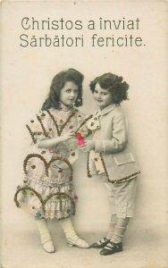 Romania children girls Christ is risen Easter greetings dress novelty postcard