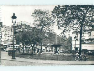 old rppc ANTIQUE MOTORCYCLE PARKED ALONG THE FENCE Paris France HM1568