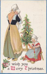 TUCK #534, CHRISTMAS; We wish you a Merry Christmas, Dutch Mother holding bab...