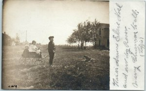 Vintage 1910s RPPC Real Photo Postcard Boy Pulling Toy Wagon w/ Brother & Sister
