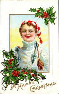 A HAPPY CHRISTMAS POSTCARD YOUNG GIRL DRESSED FOR ICE SKATING HOLDING SKATES
