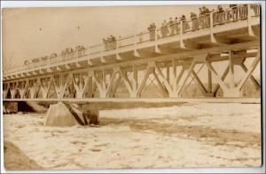 RPPC, Bridge and Ice Jam on a River. Location Unknown.