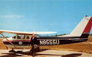 Photo of company aircraft and Melvin R Brown, president of home fashions Inc....
