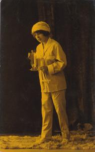 RP; Woman wearing pajamas holding lit candle, 20-30s