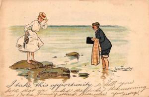 Greetings Beach Scene Romance Man with Camera Vintage Postcard JE228290