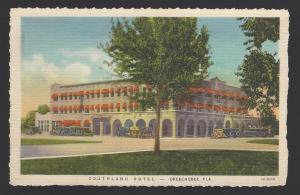 Southland Hotel, Okeechobee, Florida. Vintage autos outside