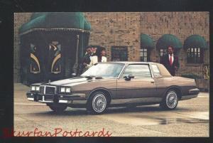 1984 PONTIAC GRAND PRIX VINTAGE CAR DEALER ADVERTISING POSTCARD