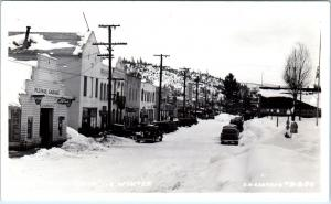 RPPC QUINCY, CA California  STREET SCENE in Snow FORD Sign c1940s Cars Eastman