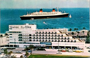 Yankee Clipper Hotel with SS France in ocean nearby vtg cars boats cruise ship