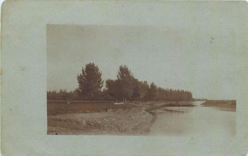 Vintage real photo postcard to identify river valley landscape
