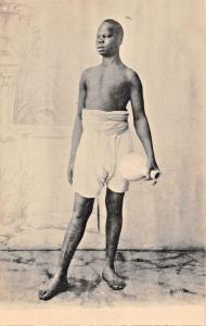TYPICAL AFRICAN MAN POSES IN NATIVE ATTIRE HOLDING JUG PHOTO POSTCARD