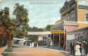 LP07   Put In Bay Ohio Postcard  Postal Shop Along Pike  Oelschlager Hotel