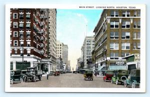 Postcard TX Houston Main Street Looking North Old Cars Drug Store c1930s J3