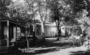 Pt Point Pleasant Minnesota~North Side Cottages~Ladies in Lawn Swing~1909 RPPC