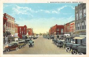 Owosso Michigan view of Washington St N business district antique pc (Y7605)