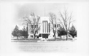 Russell Kansas County Court House~Man Running on Sidewalk~Bare Trees~c1940s RPPC