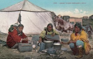 Eskimo women preparing a meal , Alaska, 1900-10s