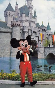DISNEYLAND, California, 1965 ; Mickey Mouse in front of Sleeping Beauty Castle
