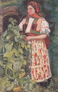 Woman in traditional costume standing next to plant by A. Kalvoda, 00-10s