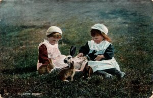 """Children Two Young Girls Playing With Rabbits A Happy Family 1907 Tucks """"..."""