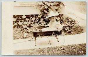 RPPC Baby Girl w/Pretty Hat Fits Snug in Her Reliant Brand Toy Wagon~Spokes~1910