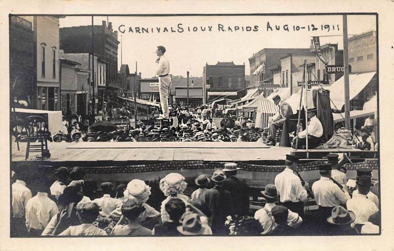 Sioux Rapids IA Carnival Tight Rope Walker Storefronts 1911 RPPC