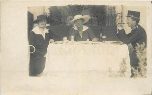 Vintage photo postcard military man cigar smocker at a table with two women