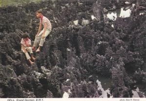 Boys sit on Black Coral , HELL , Grand Cayman , B.W.I. , PU-1985