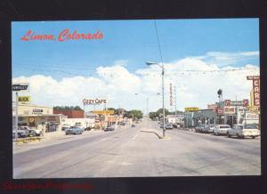 LIMON COLORADO 1960's CARS STREET SCENE CHEVROLET CAR DEALER POSTCARD 7up SIGN