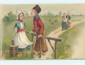 Pre-Linen foreign EUROPEAN GIRL AND BOY TALKING AT RAILING J5262