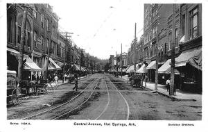 Hot Springs AR Central Ave. Horse & Wagons Trolley Store Fronts RPPC Postcard