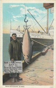 KETCHIKAN , Alaska 1910s ; Man with King Salmon
