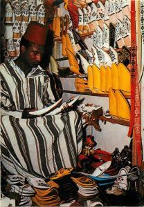 Morocco Marrakech - The Slipper Market ethnic seller commerce
