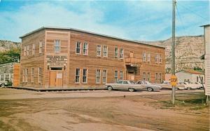 Medora North Dakota~Corner Entrance to Rough Riders Hotel~1960s Cars