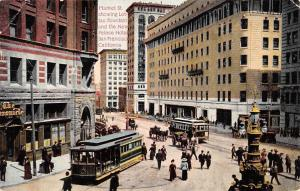 USA CA. San Francisco Market St. showing Lottas Fountain New Palace Hotel trams