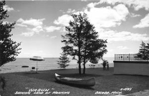 Oscoda Michigan~Beach Scene Wabun Shining Land of Morning~Canoe in Front~RPPC