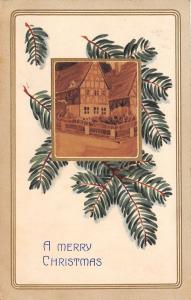 Christmas~English Village Inset on Pine Needle Branch~Tan Back~Embossed~1908 PC