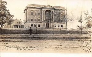 Stanton MI~Man Standing in Front of Courthouse~New Trees~Jail Behind? RPPC c1914