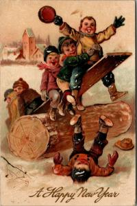 PFB New Year~Boys on Log Plank Teeter Totter~Snow~Embossed~Serie 9641~1910 PC
