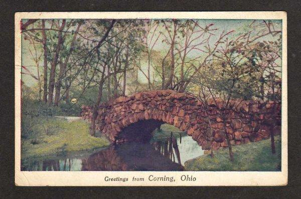 OH Greetings from CORNING OHIO Postcard Stone Bridge