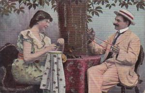 Romantic Couple Sitting At Table With Yarn